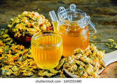 Chinese Chrysanthemum Tea in cup and  teapot on wood table, health herbal tea.
