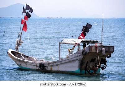 A chinese civilian fishing boat anchored near the sea port at Houmen, Guangdong China.