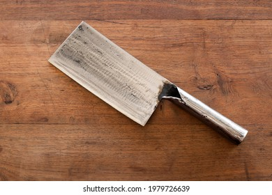 Chinese cleaver knife placed on old wooden table