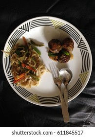Chinese cuisine hakka noodles and veg Manchurian fork and spoon in the white plate