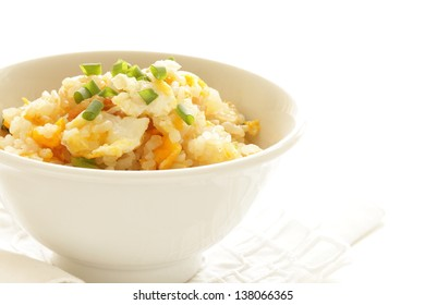 chinese cuisine, pork and egg fried rice on white background with copy space