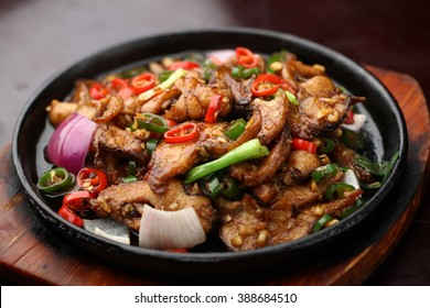 Chinese cuisine served on a sizzling plate