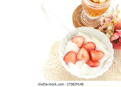 Chinese cuisine, strawberry and Almond Tofu with iced tea