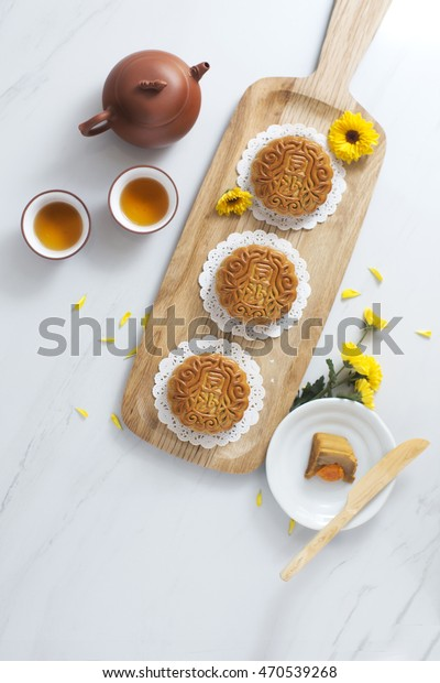Chinese cultural mid autumn festival celebration table top shot. Flat lay overhead view mooncakes and Chinese tea set one marble table top. Shallow depth of field,