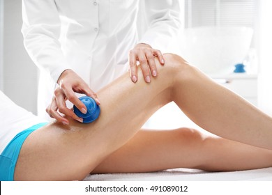 . Chinese cupping massage thigh. Beautician massaged can women rubber bubbles massage.