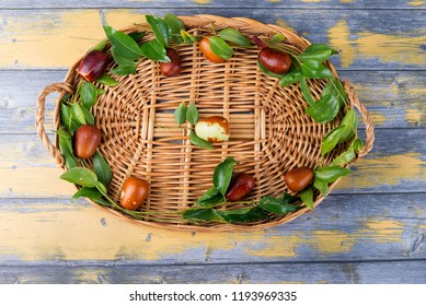 Chinese date fruits-Ziziphus jujuba fruits on a wicker tray. background and texture