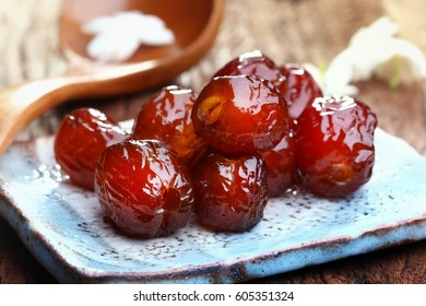 Chinese date, Jujube or monkey apple boiled with syrup. Chinese date link or Jujube link is best dessert and best tradition chinese medicine. Thai dessert : Sweet dried Chinese Jujube.