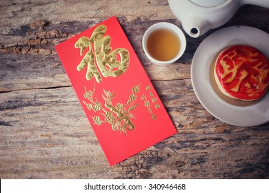 Chinese dessert with red envelope in chinese new year festival