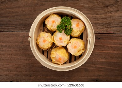 Chinese dim sum in a bamboo steamer box