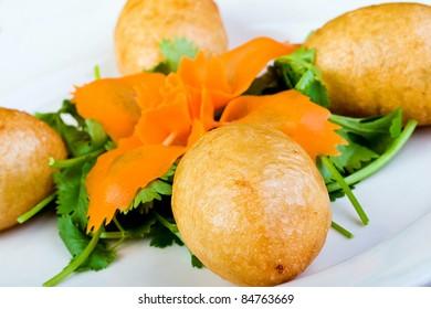 Chinese Dim Sum round breaded dumplings.