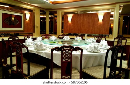 Chinese dining, round table set in room, business dinner