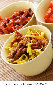 Chinese dish - noodle with fried beef close-up