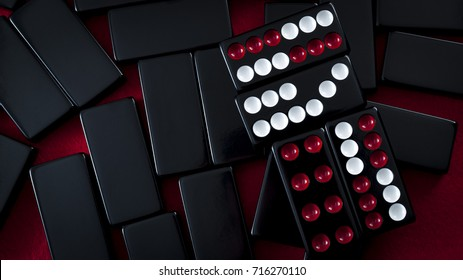 Chinese dominos and casino gambling concept with a Pai Gow tiles hand made of a Wong and a Gong on red background with copy space