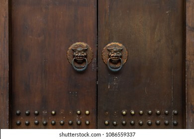 A chinese door with a knocker