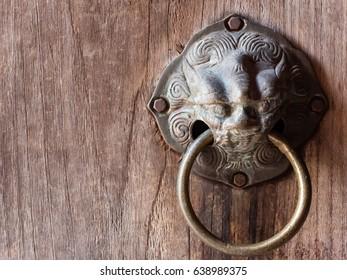 chinese dragon head door knocker on wooden door