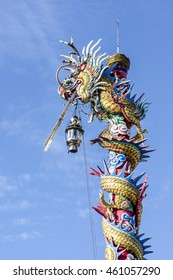 The Chinese dragon statue with blue sky background.