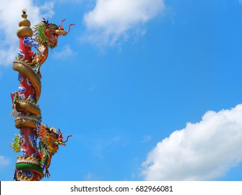 Chinese dragon statue climbs the sky background.