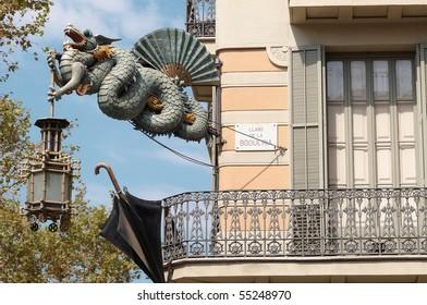 Chinese Dragon and umbrella, modernism architecture (Casa Bruno Cuadros), in the Ramblas. Barcelona, Catalonia, Spain