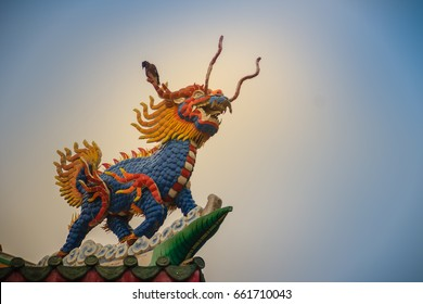 Chinese dragon-headed unicorn statue on the temple roof. Kylin or Kirin on roof in Chinese temple.