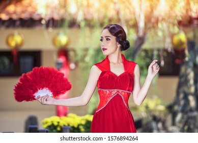 Chinese dress,Asian woman in chinese dress traditional cheongsam. Beauty woman wear Cheongsam  in chinese new year.