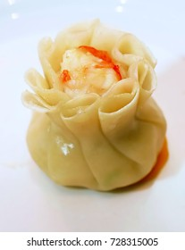 Chinese dumpling with chopsticks