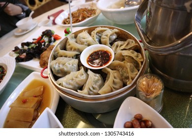 Chinese dumpling on the dinner table full of food at Changsha - Hunan, China.