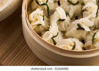 Chinese dumplings in bamboo steamers
