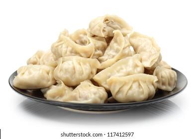 Chinese dumplings on white background