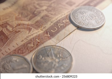 Chinese economy concept, Chinese currency with curves. Multiple exposure photo.