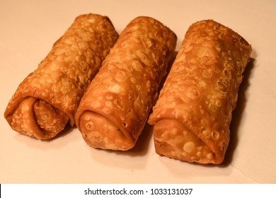 Chinese Eggrolls On A White Background