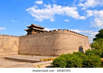 Chinese element- tower and rampart of the city. It is th west gate of historical town-Yuci. The Yuci is a city in Shanxi China. It is near the old town of Pingyao.