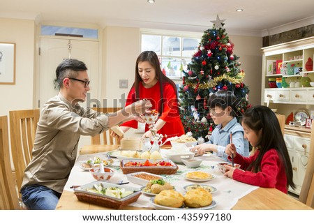 chinese family enjoying their christmas dinner they are eating traditional chinese food the