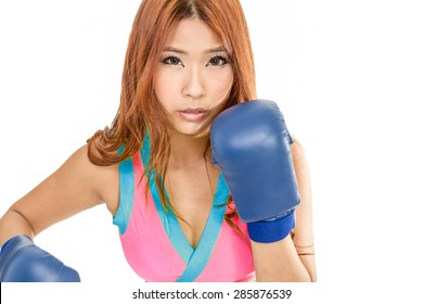 Chinese female in pink top wearing boxing gloves