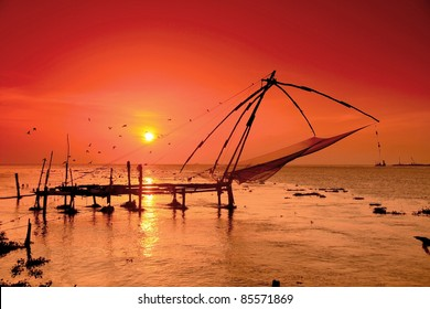 Chinese fisher-nets in Cochin, nowadays only used for displaying fishing techniques for tourists. Works with pulleys and weights, the net is tied over a teak frame.