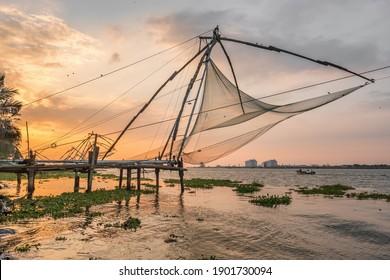 Chinese fishing net at sunrise in Cochin, Kerala, India. Famous landmark in Fort Kochi