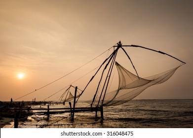 Chinese fishing nets in Cochin, Kerala, India. at sunset.