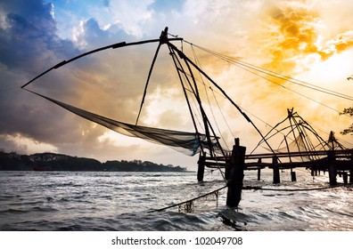 Chinese Fishing nets at dramatic sunset sky background on Vypeen Island in Kochi, Kerala, India