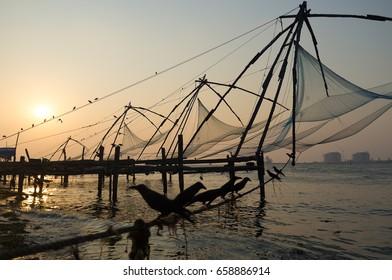 Chinese fishing nets in Kochi at sunset