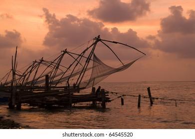 Chinese fishing nets lining the shore at Fort Kochi, Kerala, India