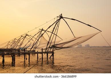 Chinese fishing nets on sunset background  in Cochin (Kochi), Kerala, India