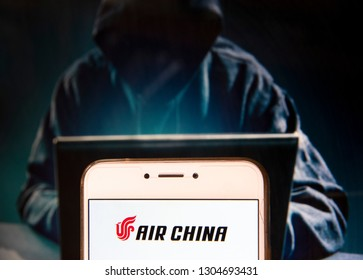 Chinese flag carrier Air China logo is seen on an Android mobile device with a figure of hacker in the background.