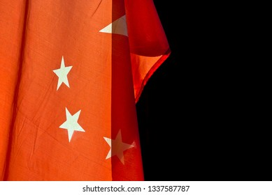 Chinese flag hanging down with black background