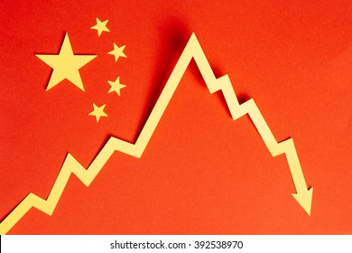 Chinese flag made with cardboard and a downward graph to illustrate financial crisis and economic slowdown.