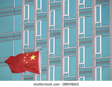 Chinese flag with modern office building. The picture was taken in New York in 2014.