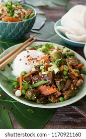 Chinese food with beef, rice and veggies