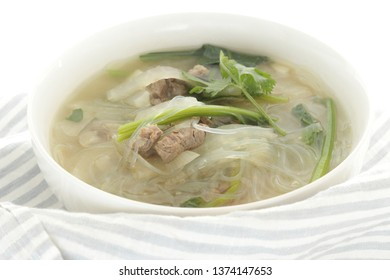 Chinese food, beef and spinach with glass noodles soup