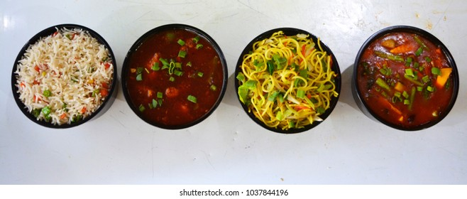 Chinese food bowls, chilli chicken gravy, hakka noodles, fried rice, and chilli paneer