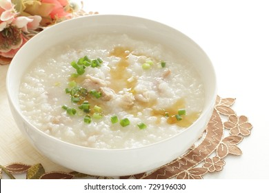 Chinese food, chicken congee with sesame oil and scallion on top