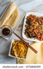 Chinese food Moo shu pork with Mandarin pancake wrappers and hoisin black bean dipping sauce