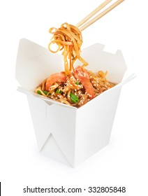 Chinese food. Noodles with shrimp isolated on white background. Opened take out box.